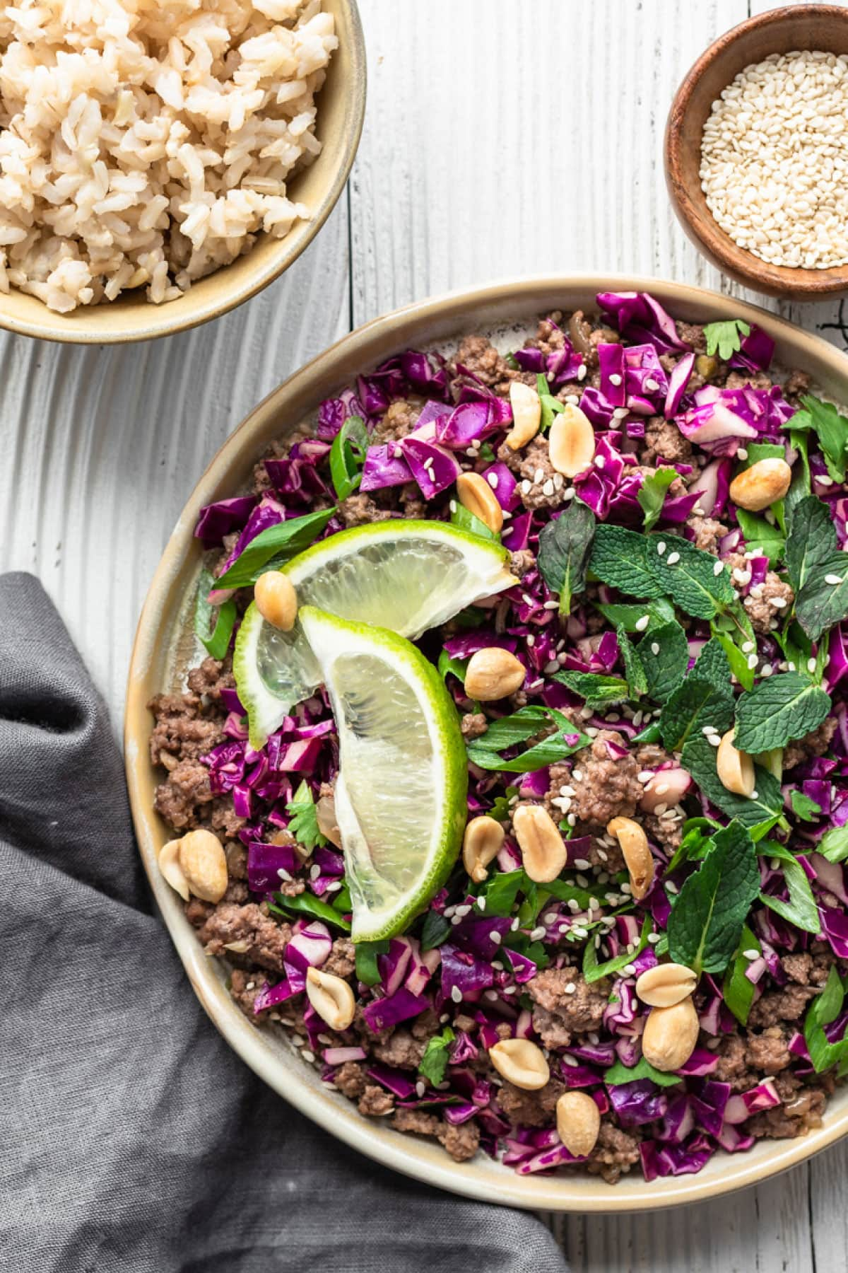 thai larb bowl with a small bowl of rice