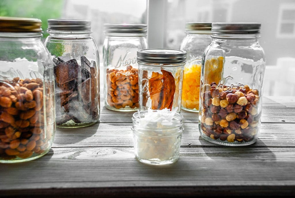 tropical trail mix ingredients in mason jars